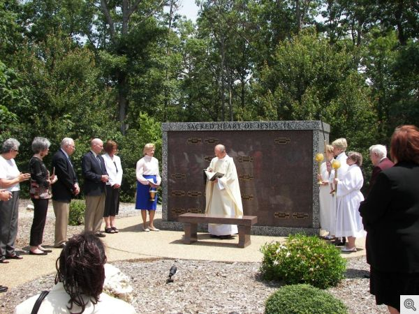 Fr. Bill conducting an inurnment ceremony at the Sacred Heart Columbarium